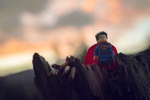 superman lego piece helping others out of weakness